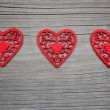 Three hearts on wooden background — Stock Photo #17010839