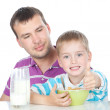 Happy family having breakfast together — Stock Photo #17010845