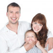 Smiling parents with little son posing on white — Stock Photo