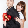 Happy young couple with red hearts — Stock Photo