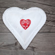 Big white heart on wooden background - Stock Photo