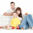 Smiling parents with little son over white - Stock Photo