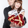Happy young couple with red hearts - Stock Photo