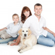 Stock Photo: A young family with a dog