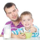 Happy family having breakfast together — Stock Photo