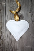 Big white heart on wooden background — Stock Photo