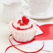 Strawberry cupcake on a table - Stock Photo
