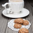 Cup of tea and cookies on wooden background — Stockfoto