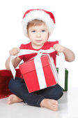 Picture of funny child opening christmas present over white — Stock Photo