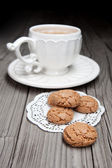 Cup of tea and cookies on wooden background — Stock Photo