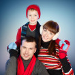 Happy family having fun at winter time — Stock Photo