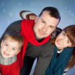Happy family having fun at winter time — Stock Photo