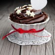 Chocolate cupcake on wooden table — Stock Photo #19929885