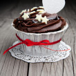 Chocolate cupcake on wooden table — Stock Photo