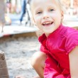 Little girl playing on a sandbox — Stock Photo