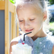 Little girl with ice cream milk shake outdoor — Stock Photo