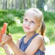 Funny child eating watermelon in the park — Stock Photo