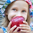 Picture of little girl with red apple — Stock Photo