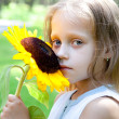 Funny  little girl in a park — Stock Photo