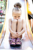 Little girl playing on a playground — Stock Photo