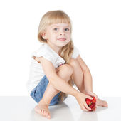 Little girl with strawberry — Stock Photo