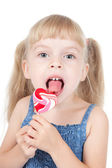 Little girl with candy — Stock Photo
