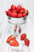 Bucket with strawberries — Stock Photo
