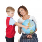 Teacher helping elementary student — Stock Photo