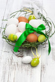 Easter eggs in a nest — Stockfoto