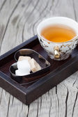 Cup of tea with brown sugar — Stock Photo