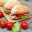 Stockfoto: Sandwiches on wooden background