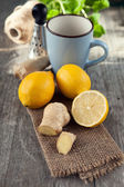 Ginger root and lemons — Stock Photo