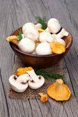 Mushrooms on a wooden table — Stock Photo