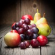 Harvested grapes, apples, ripe pears and plums — Stock Photo #41924965
