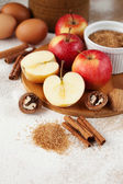 Apples and baking ingredients — Stock Photo