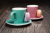 Coffee cups with french macaroons — Stock Photo