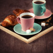 Coffee cups and croissants — Stock Photo