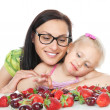 Happy mother and little girl with berries — Stock Photo