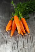 Carrots on a wooden background — Stock Photo