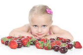 Little girl with red berries on white — Stock Photo