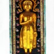 Buddha statue on wall — 图库照片