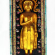 Buddha statue on wall — Stockfoto