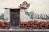 The old wood window at the old wall — Stock Photo