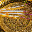 Candle with joss stick ontray with pedesta — Stock Photo