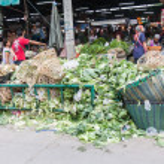 Pile of vegetable throw away as garbage at fresh-food market — Stock Photo #33470447