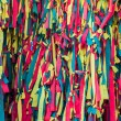 Stock Photo: Colourful peaces of clothes be bind together on tree
