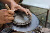 Potter is molding and craving the clay. — 图库照片
