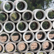 Stock Photo: Stack of concrete pipes