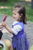 Adorable little cute girl with icecream — Stock Photo