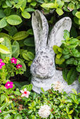 Rabbit doll in garden — Stock Photo